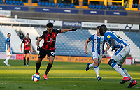 13th April 2021; The John Smiths Stadium, Huddersfield, Yorkshire, England; English Football League Championship Football, Huddersfield Town versus Bournemouth; Junior Stanislas of Bournemouth lines up a shot as he is challenged by Mouhamadou-Naby Sarr of Huddersfield Town