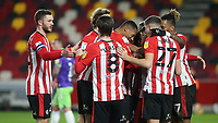 Brentford players congratulate Saman Ghoddos after scoring their third goal during Brentford vs Bristol City, Sky Bet EFL Championship Football at the Brentford Community Stadium on 3rd February 2021