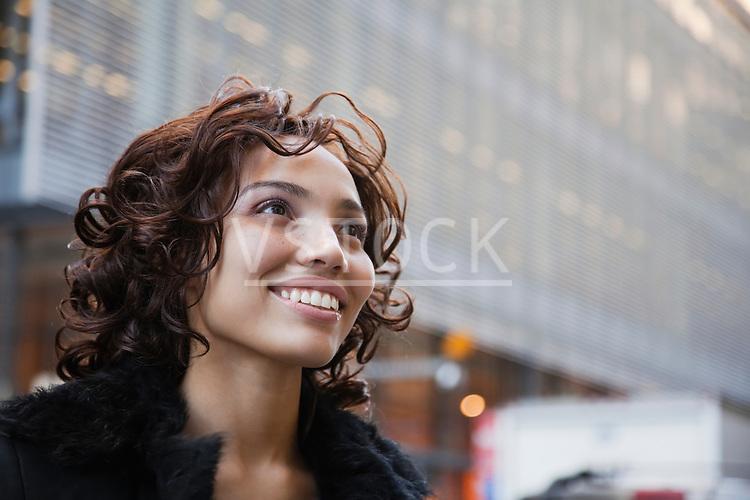 USA, New York, New York City, portrait of smiling woman on street