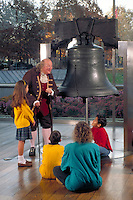Ben Franklin (look alike) tells children aged 8-12 the story of early Philadelphia. School children, teacher and Ben Franklin actor. Philadelphia Pennsylvania United States Liberty Bell.