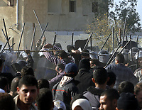 "Gaza.25.01.2008Egyptian police officers clash with Palestinians trying to cross the border between Gaza Strip and Egypt, in the Gaza-Egypt border town of Rafah, southern Gaza Strip, 25 January 2008. Palestinians rushed home to the Gaza Strip Friday afternoon, as a 3 pm (1300 GMT) deadline set by Egypt for them to return expired. Egyptian border guards, who had been gradually re-closing the border since the morning, fired multiple volleys of gunfire into the air as they tried to impose the deadline, witnesses said.""photo by Fady Adwan"