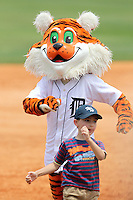 Lakeland Flying Tigers mascot loses the base race to a young fan during a game against the Daytona Cubs at Joker Marchant Stadium on April 29, 2012 in Lakeland, Florida.  Lakeland defeated Daytona 6-4.  (Mike Janes/Four Seam Images)