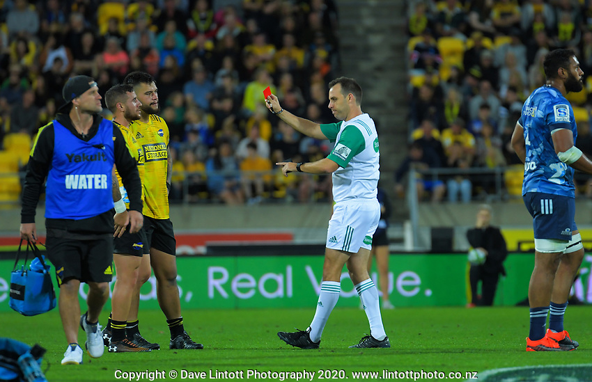 Referee Mike Fraser sends off Hurricanes prop Tyrell Lomax during the Super Rugby match between the Hurricanes and Blues at Sky Stadium in Wellington, New Zealand on Saturday, 7 March 2020. Photo: Dave Lintott / lintottphoto.co.nz
