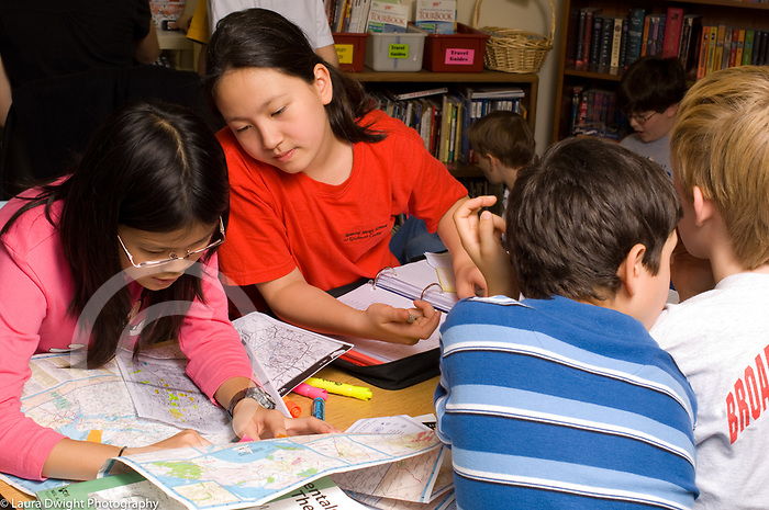 Public School Elementary school grade 5 two girls working on mapping project in class