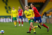 20th March 2021; Carrow Road, Norwich, Norfolk, England, English Football League Championship Football, Norwich versus Blackburn Rovers; Todd Cantwell of Norwich City is under pressure from Stewart Downing of Blackburn Rovers