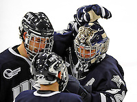 1 February 2008: University of New Hampshire Wildcats' goaltender Kevin Regan, a Senior from South Boston, MA, gets congrats from teammates after game action against the University of Vermont Catamounts at Gutterson Fieldhouse in Burlington, Vermont. Regan made 19 saves to lift the seventh-ranked Wildcats to a 5-1 victory against Vermont in front of a sellout crowd of 4,003...Mandatory Photo Credit: Ed Wolfstein Photo