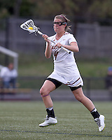 Boston College attacker Brooke Blue (4) brings the ball forward. Boston College defeated University of Vermont, 15-9, at Newton Campus Field, April 4, 2012.