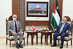 Palestinian President Mahmoud Abbas, meets with Canadian Foreign Minister Marc Garneau in the West Bank city of Ramallah, on July 5, 2021. Photo by Thaer Ganaim