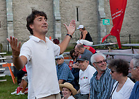 Liberal Party of Canada leader Justin Trudeau gestures as he talk to a group of concert goersat the Festival de Musique Militaire in Quebec City, Wednesday August 21, 2013.<br /> <br /> PHOTO :  Francis Vachon - Agence Quebec Presse