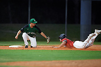 Dartmouth Big Green third baseman Justin Fowler (25) tags Ryan Solomon (31) out during a game against the Northeastern Huskies on March 3, 2018 at North Charlotte Regional Park in Port Charlotte, Florida.  Northeastern defeated Dartmouth 10-8.  (Mike Janes/Four Seam Images)