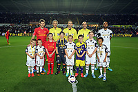 Pictured: Steven Gerrard (L) and Ashley Williams (R) with children mascots and the referees.<br /> Monday 16 September 2013<br /> Re: Barclay's Premier League, Swansea City FC v Liverpool at the Liberty Stadium, south Wales.