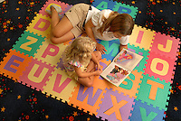 A teacher reads to a young student at Berewick master-planned community in southwest Mecklenburg County, Charlotte, NC. The property is developed by Pappas Properties.