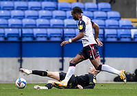 Bolton Wanderers' Nathan Delfouneso competing with Oldham Athletic's Jordan Barnett (left) <br /> <br /> Photographer Andrew Kearns/CameraSport<br /> <br /> The EFL Sky Bet League Two - Bolton Wanderers v Oldham Athletic - Saturday 17th October 2020 - University of Bolton Stadium - Bolton<br /> <br /> World Copyright © 2020 CameraSport. All rights reserved. 43 Linden Ave. Countesthorpe. Leicester. England. LE8 5PG - Tel: +44 (0) 116 277 4147 - admin@camerasport.com - www.camerasport.com