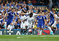 Bafetimbi Gomis of Swansea in action   during the Barclays Premier League match between  Chelsea and Swansea  played at Stamford Bridge, London