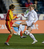 Amy Rodriguez (8) of the USWNT collides with Yu Fan (3) of China during an international friendly at PPL Park in Chester, PA.  The U.S. tied China, 1-1.