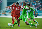 Claudio Pizarro of Bayern Munich and Naldo of VfL Wolfsburg in action during a friendly match as part of the Audi Football Summit 2012 on July 26, 2012 at the Guangdong Olympic Sports Center in Guangzhou, China. Photo by Victor Fraile / The Power of Sport Images