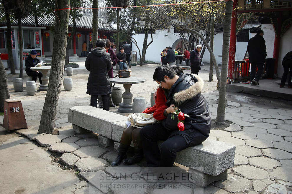 A couple embrace in the grounds of Guiyuan Temple in Wuhan, central China.<br /> <br /> To license this image, please contact the National Geographic Creative Collection:<br /> <br /> Image ID: 1933602 <br />  <br /> Email: natgeocreative@ngs.org<br /> <br /> Telephone: 202 857 7537 / Toll Free 800 434 2244<br /> <br /> National Geographic Creative<br /> 1145 17th St NW, Washington DC 20036