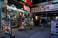 NEW YORK, NY - NOVEMBER 16: People pass by a souvenir store in Times Square on November 16, 2020 in New York. Some souvenir shops are closing and others struggling to survive the covid-19 pandemic, as no tourist visit NYC due to the virus surging again and many travel restrictions still in place, where international arrivals in main airports were down by 93 percent, according to Port Authority data. (Photo by Eduardo MunozAlvarez/VIEWpress)