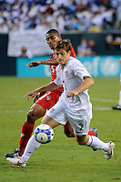 Robbie Rogers (7) of the United States (USA) is marked by Gabriel Gomez (6) of Panama. The United States (USA) defeated Panama (PAN) 2-1 during a quarterfinal match of the CONCACAF Gold Cup at Lincoln Financial Field in Philadelphia, PA, on July 18, 2009.