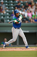 Third baseman Carlos Diaz (14) of the Lexington Legends swings at a pitch during a game against the Greenville Drive on Saturday, September 1, 2018, at Fluor Field at the West End in Greenville, South Carolina. Greenville won, 9-6. (Tom Priddy/Four Seam Images)