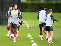 14th September 2021: The  AXA Training Centre, Kirkby, Knowsley, Merseyside, England: Liverpool FC training ahead of Champions League game versus AC Milan on 15th September: Virgil van Dijk of Liverpool warms up with his team mates