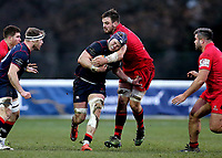 Matt Eliet of London Scottish is tackled during the Greene King IPA Championship match between London Scottish Football Club and Jersey at Richmond Athletic Ground, Richmond, United Kingdom on 16 December 2017. Photo by Mark Kerton / PRiME Media Images.