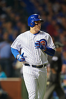 Chicago Cubs Anthony Rizzo (44) jogs to first while keeping an eye on the ball in the first inning during Game 3 of the Major League Baseball World Series against the Cleveland Indians on October 28, 2016 at Wrigley Field in Chicago, Illinois.  (Mike Janes/Four Seam Images)
