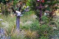 Meadow garden with grasses and whimsical cow skull on post - Barbata garden, Walnut Creek, California