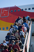 Passengers boarding a plane at Madrid-Barajas Airport, Madrid, Spain.