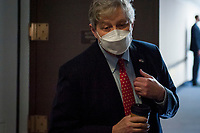 United States Senator John Neely Kennedy (Republican of Louisiana) fields questions from reporters regarding President Trump's recent remarks about slowing down testing for COVID-19 as he arrives for the GOP luncheon in the Hart Senate Office Building on Capitol Hill in Washington, DC., Tuesday, June 23, 2020. Credit: Rod Lamkey / CNP/AdMedia