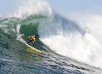 """Grant """"Twiggy"""" Baker surfs during the final heat of the 2008 Mavericks Surf Contest in Half Moon Bay, Calif., Saturday, January 12, 2008."""