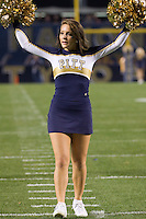a Pitt dance team girl leads a cheer.The Pittsburgh Panthers beat the UCONN Huskies 35-20 at Heinz field in Pittsburgh, Pennsylvania on October 26, 2011.