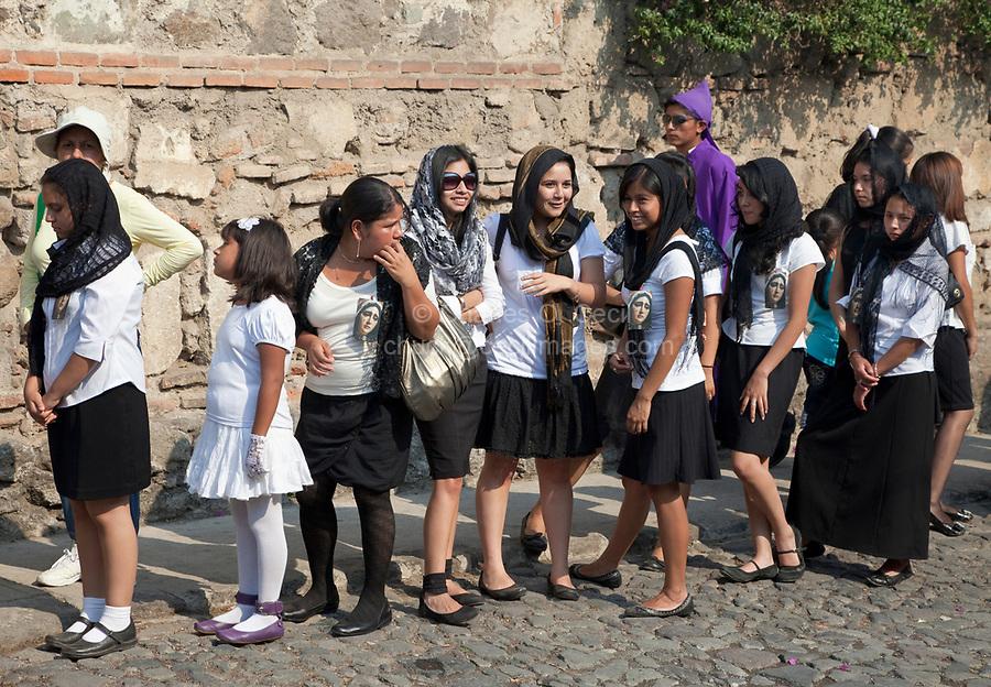 Antigua, Guatemala.  Semana Santa (Holy Week).  Young Women Escorting a Religious Procession.