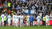 Finland's players celebrate with their supporters after international match of the qualifiers for the FIFA World Cup Brazil 2014.March 22,2013.(ALTERPHOTOS/Victor Blanco)