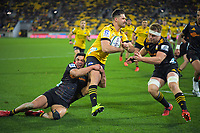 Chiefs Anton Lienert-Brown and Sam Cane (right) tackle Hurricanes Kobus van Wyk during the Super Rugby Aotearoa match between the Hurricanes and Chiefs at Sky Stadium in Wellington, New Zealand on Saturday, 8 August 2020. Photo: Dave Lintott / lintottphoto.co.nz
