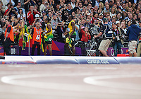 August 05, 2012: Yohan Blake and Usain Bolt walk towards the fans after second and first place in men's 100m dash at the Olympic Stadium on day nine of 2012 Olympic Games in London, United Kingdom.