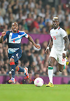 July 26, 2012..Britain's Danny Rose (4) and Senegal's Pape Souare (16). Great Britain vs Senegal Football match during 2012 Olympic Games at Old Trafford in Manchester, England. Senegal held Great Britain to a 1-1 draw...(Credit Image: © Mo Khursheed/TFV Media)