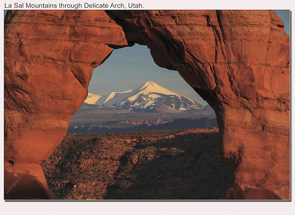 La Sal Mountains framed by Delicate Arch, Arches National Park, Utah. <br />
