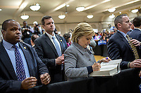Democratic Presidential candidate Hillary Clinton, surrounded by security personnel, signs books during a 'Get Out the Vote' event at the Chicago Journeymen Plumber's Local Union.