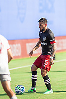 LAKE BUENA VISTA, FL - JULY 13: Junior Moreno #5 of DC United passes the ball during a game between D.C. United and Toronto FC at Wide World of Sports on July 13, 2020 in Lake Buena Vista, Florida.