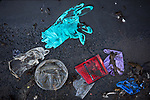 Gloves litter the street across from Brooklyn Medical Center during the coronavirus pandemic on April 6, 2020 in New York City.  More than 10,000 people have died from COVID-19 in the U.S..  Photograph by Michael Nagle