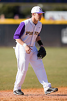Shortstop Dustin Harrington #7 of the East Carolina Pirates on defense versus the Virginia Cavaliers at Clark-LeClair Stadium on February 19, 2010 in Greenville, North Carolina.   Photo by Brian Westerholt / Four Seam Images