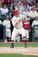 Arkansas Razorbacks outfielder Joe Serrano (10) bunts at Baum Stadium during the NCAA baseball game against the Alabama Crimson Tide on March 21, 2014 in Fayetteville, Arkansas.  The Alabama Crimson Tide defeated the Arkansas Razorbacks 17-9.  (William Purnell/Four Seam Images)