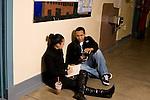 High school students talking in corridor between classes.