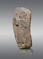 Hittite monumental relief sculpture of a figure holding a document. Adana Archaeology Museum, Turkey. Against a grey background