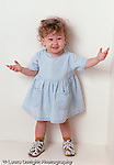 toddler girl 20 mos. old portrait, full length, arms outstreched