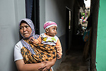29 JAN, 2018, Bandung, Indonesia: Ibu (Mrs) Meni with her baby Kayla (9 months) from Pangkalan village, Cihaur sub district, West Bandung commenting on the health problems of village residents as a result of river pollution. The Citarum river in West Java, Indonesia is listed as one of the most polluted rivers in the world.  It will soon be the main water supply system for Jakarta as the bores that have been dug into the aquifers dry but it also supports agriculture, fishery, industry, sewerage and electricity.      Picture by Graham Crouch/The Australian