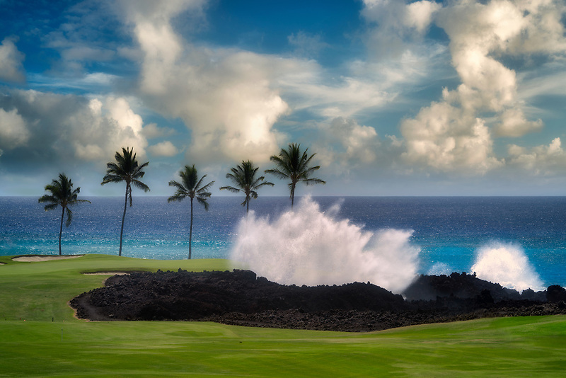Crashing waves, palm trees and golf course. Hilton Waikoloa Beach Golf Resort. Hawaii, The Big Island