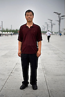 Zhengshiwen, an electrician, age 21, poses for a portrait in Beijing. Response to 'What does China mean to you?': 'My own country.'  Response to 'What is China's role in the future?': 'The people will be even more harmonious.'