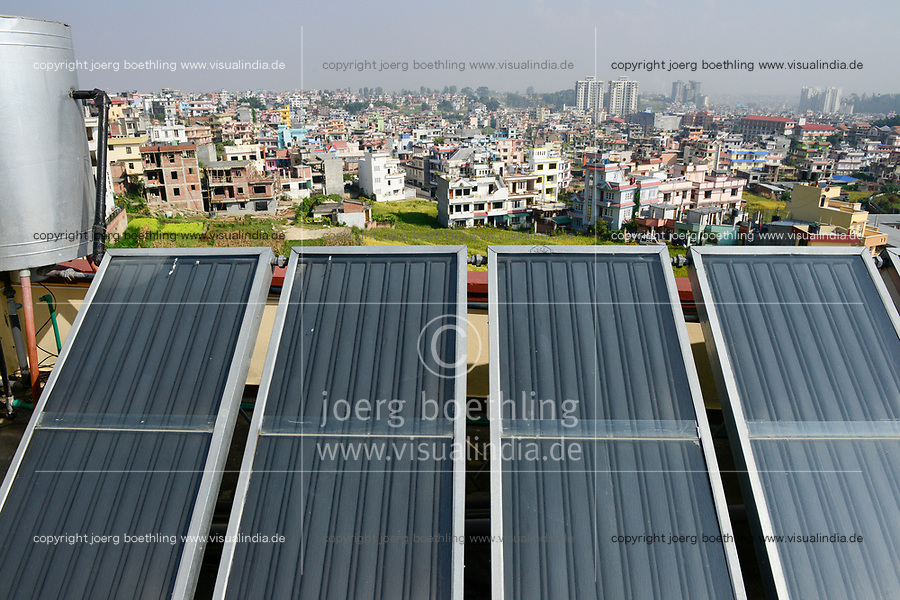 NEPAL Kathmandu, appartment building with solar collector for water heating / Haus mit Sonnenkollektor fuer Warmwasseraufbereitung
